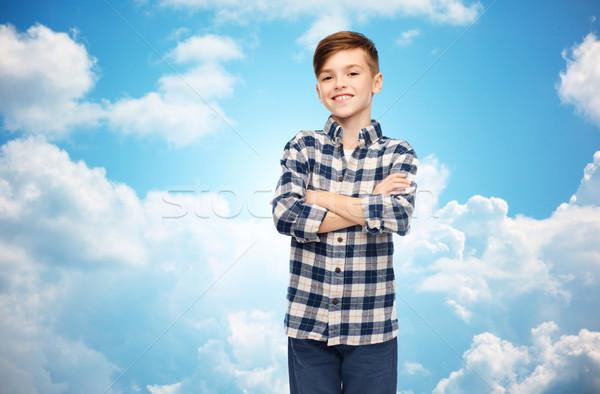 Souriant garçon à carreaux shirt ciel bleu Homme Photo stock © dolgachov