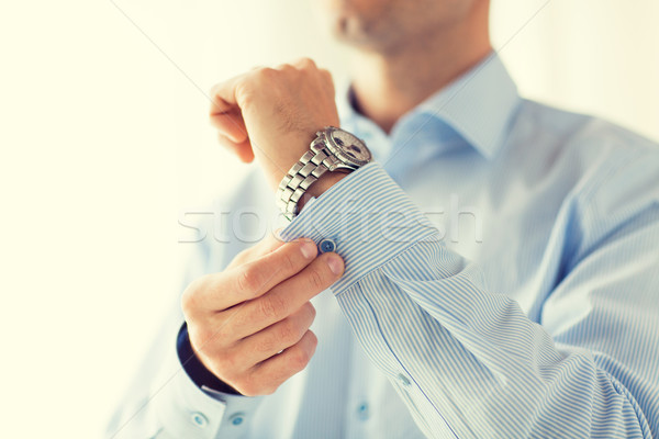 Homme boutons shirt douille personnes Photo stock © dolgachov