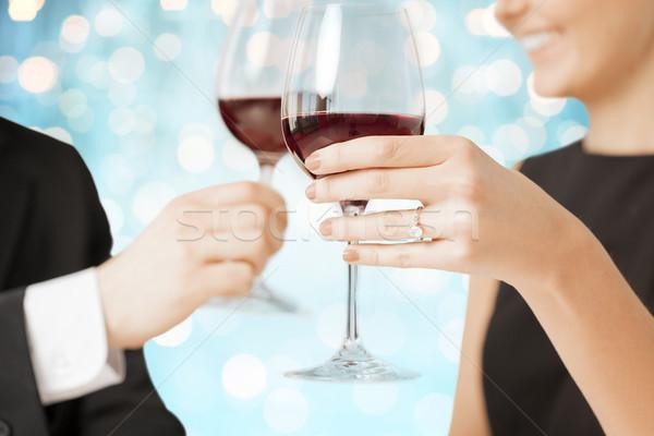 happy engaged couple clinking wine glasses Stock photo © dolgachov