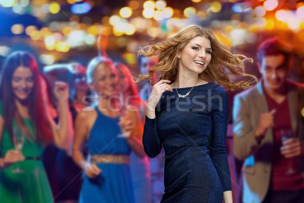 Gelukkig jonge vrouw dansen nachtclub disco partij Stockfoto © dolgachov