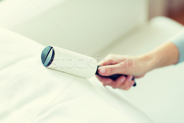 close up of woman hand with sticky roller cleaning Stock photo © dolgachov