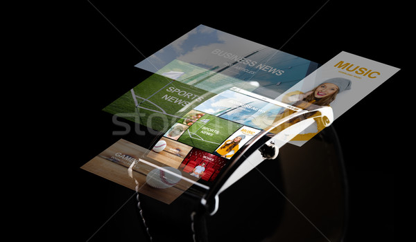 close up of smart watch with media projection Stock photo © dolgachov