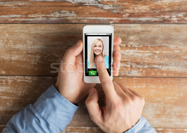 close up of hands with incoming call on smartphone Stock photo © dolgachov