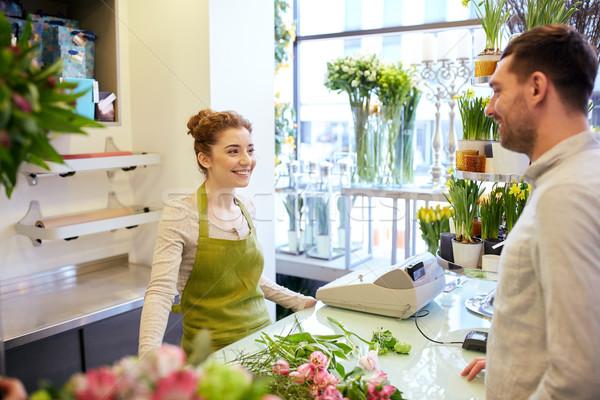 Sonriendo florista mujer hombre personas Foto stock © dolgachov