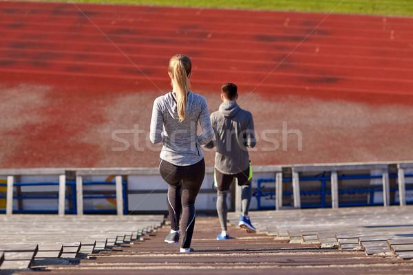 Pareja caminando estadio fitness deporte Foto stock © dolgachov