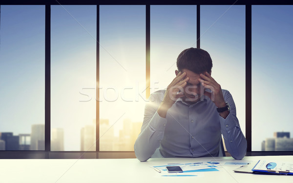 close up of anxious businessman with papers Stock photo © dolgachov