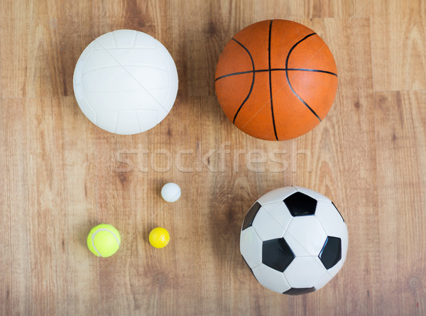 close up of different sports balls set on wood Stock photo © dolgachov