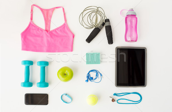 close up of tablet pc, cellphone and sports stuff Stock photo © dolgachov