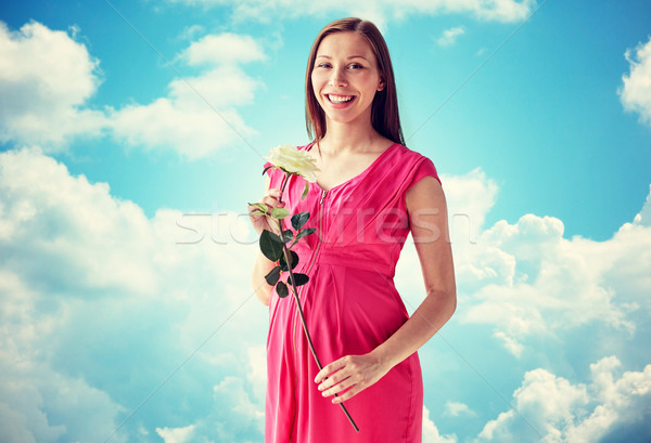 happy pregnant woman with rose flower Stock photo © dolgachov