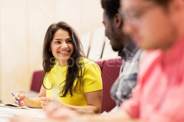 international students talking on lecture  Stock photo © dolgachov