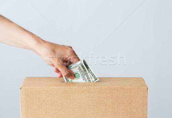 Homme dollar argent contribution boîte œuvre de bienfaisance Photo stock © dolgachov
