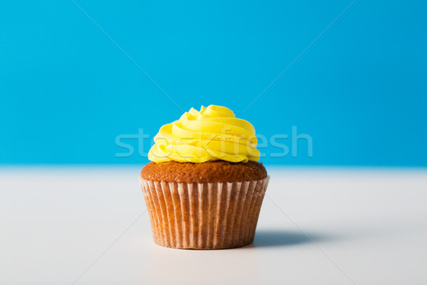 close up of cupcake or muffin with icing on table Stock photo © dolgachov