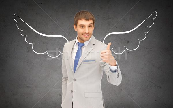 üzletember angyalszárnyak mutat remek üzlet angyal Stock fotó © dolgachov