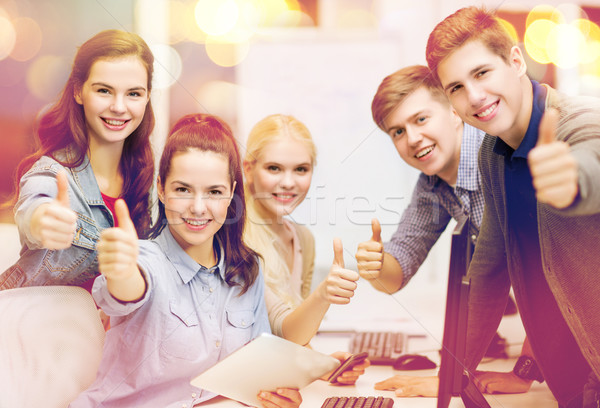 students with computer monitor and tablet pc Stock photo © dolgachov