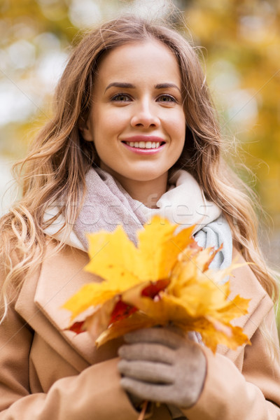 Gyönyörű nő juhar levelek ősz park évszak Stock fotó © dolgachov