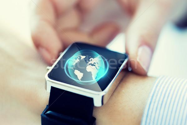 Mão globo holograma negócio tecnologia Foto stock © dolgachov