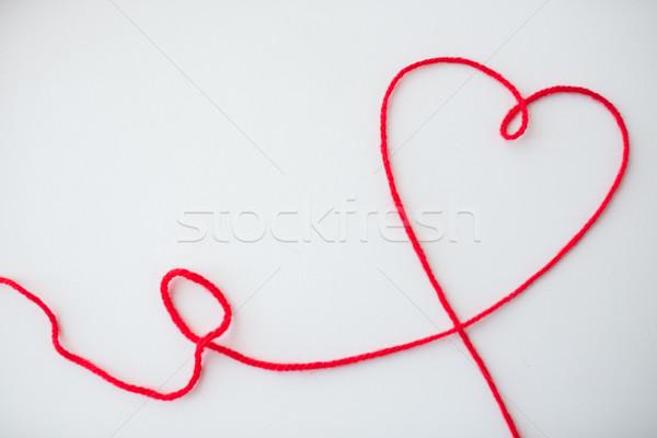 red knitting yarn thread in shape of heart Stock photo © dolgachov