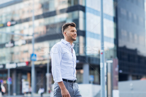 молодым человеком ходьбе городской улице жизни люди город Сток-фото © dolgachov