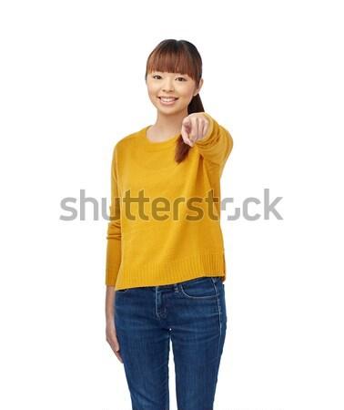 Boldog ázsiai fiatal nő mutat ujj emberek Stock fotó © dolgachov