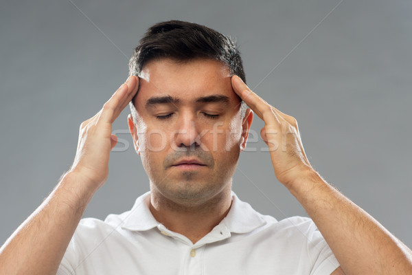 man suffering from head ache or thinking Stock photo © dolgachov