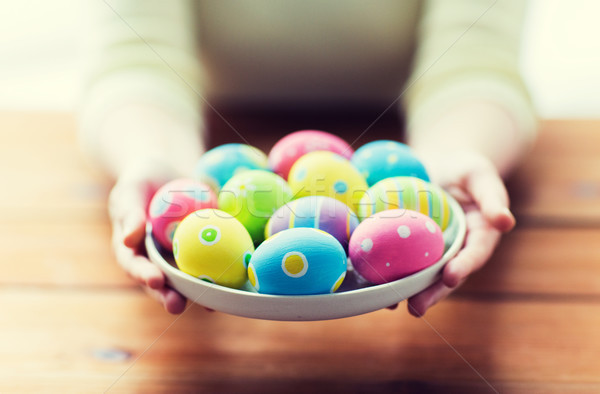 close up of woman hands with colored easter eggs Stock photo © dolgachov