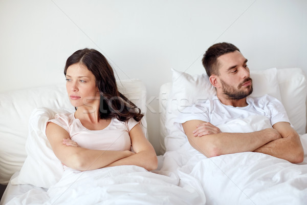 unhappy couple having conflict in bed at home Stock photo © dolgachov