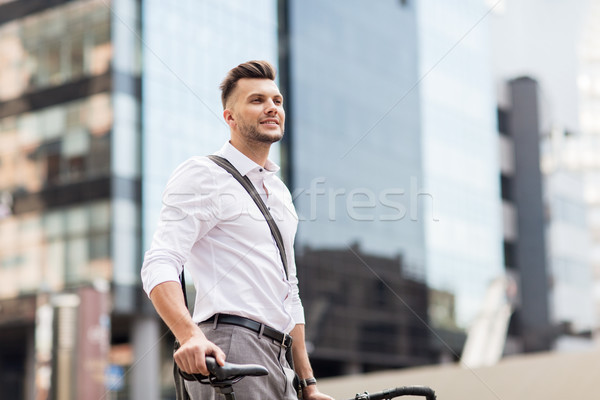 young man with bicycle on city street Stock photo © dolgachov