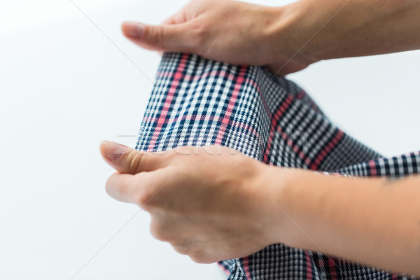 close up of hands with checkered clothing item Stock photo © dolgachov