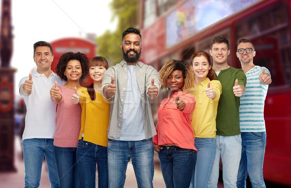 international people showing thumbs up at london Stock photo © dolgachov