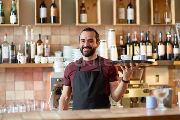 happy man or waiter with coffee and sugar at bar Stock photo © dolgachov