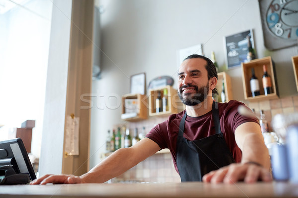 happy man or waiter at bar or coffee shop Stock photo © dolgachov