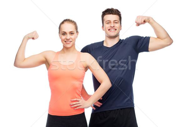 Feliz homem mulher bíceps poder Foto stock © dolgachov