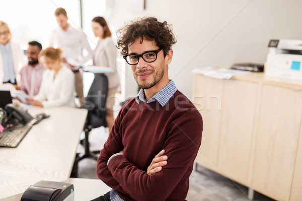 Stock photo: happy young man over creative team in office