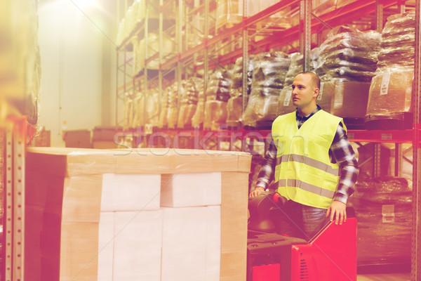 man on forklift loading cargo at warehouse Stock photo © dolgachov