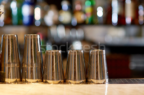 stainless steel shakers on bar counter Stock photo © dolgachov