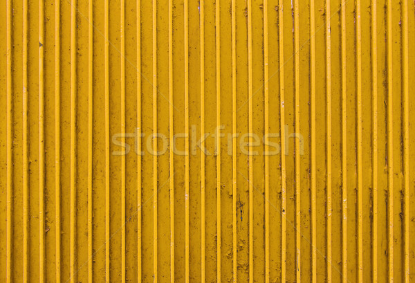 old yellow painted metal ribbed surface Stock photo © dolgachov