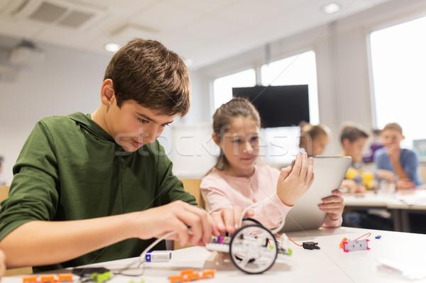 kids with tablet pc programming at robotics school Stock photo © dolgachov