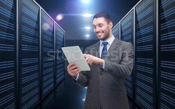 businessman with tablet pc over server room Stock photo © dolgachov