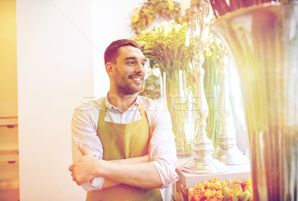 happy smiling florist man standing at flower shop Stock photo © dolgachov