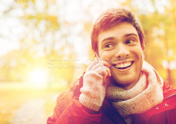 man with smartphone calling on city street Stock photo © dolgachov