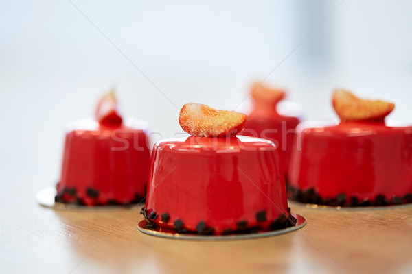 strawberry mirror glaze cakes at pastry shop Stock photo © dolgachov