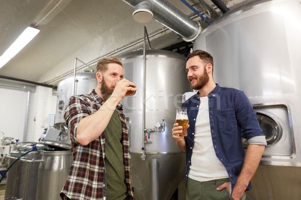 men testing non-alcoholic craft beer at brewery Stock photo © dolgachov