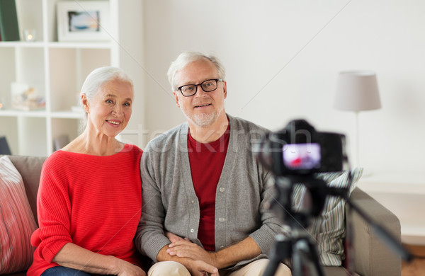 happy senior couple with camera recording video Stock photo © dolgachov