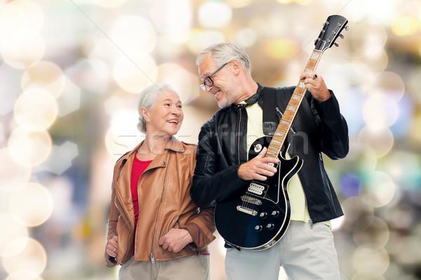 happy senior couple with electric guitar Stock photo © dolgachov