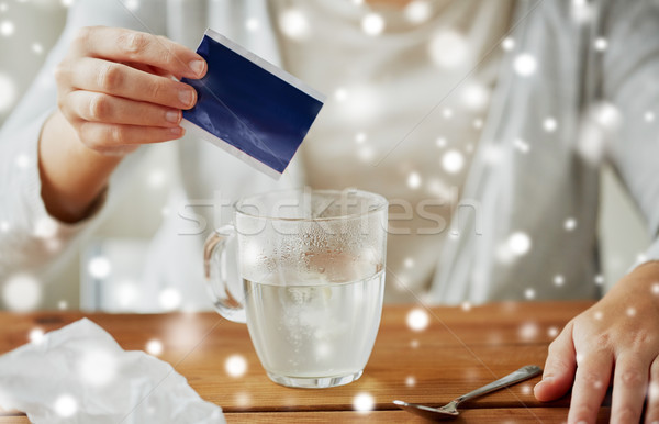 close up of ill woman pouring medication into cup Stock photo © dolgachov