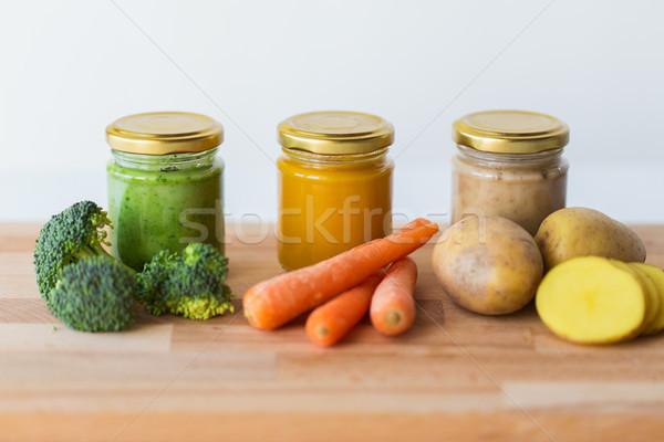 vegetable puree or baby food in glass jars Stock photo © dolgachov