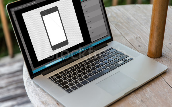 laptop with smartphone image in graphics editor Stock photo © dolgachov