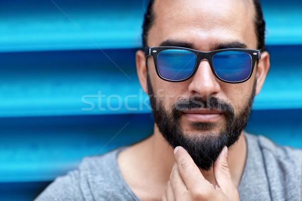 Közelkép férfi napszemüveg megérint szakáll divat Stock fotó © dolgachov