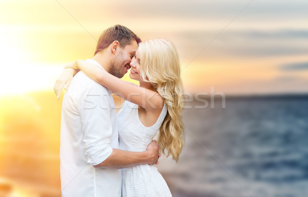 happy couple hugging and kissing on summer beach Stock photo © dolgachov