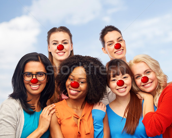 international group of happy women at red nose day Stock photo © dolgachov